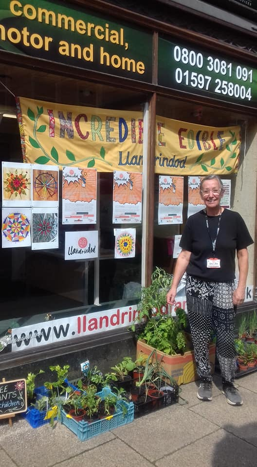 Dorienne outside the Coversure shop on Middleton Street, with some of the plants the group gave away